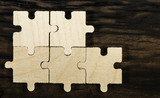 Wooden puzzle on dark background.