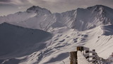 Snow covered fence winter mountain landscape Tirol time lapse
