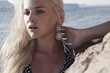 Beautiful Blond Young Woman on the Beach.Sea Landscape