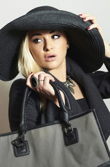 Beautiful Blond Woman in Black Hat.Lady in Topcoat.Handbag