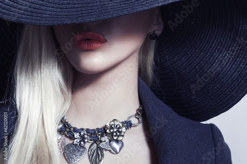 Beautiful Blond Woman in Black Hat.Spring.Accessories jewelry