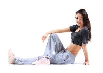 Beautiful young woman relaxing after doing exercise