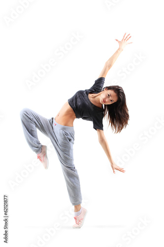 pretty modern slim hip-hop style teenage girl jumping dancing