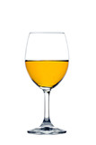 Yellow water in wine Glass isolated.