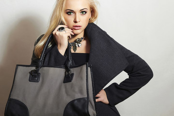 Beautiful Blond Woman in Topcoat.Beauty Girl with Handbag.Spring