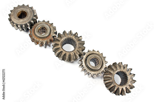Old metal cogs isolated on white