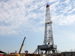 oil drilling rig and crane on field
