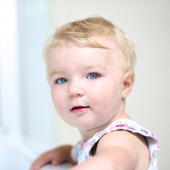 Portrait of beautiful blonde baby or toddler girl
