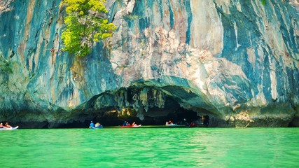 Canoeing near the limestone cliffs. Thailand, Phang Nga