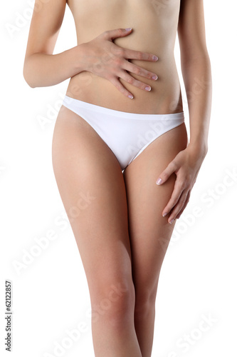 Woman's hands on stomach on white background wellness concept