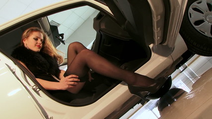 Woman posing in a car