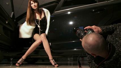 Fashion model posing in a car