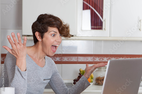 happy woman winning internet auction game or competition
