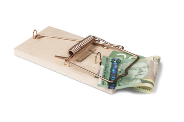 Mouse trap with Canadian dollars, isolated with clipping path.