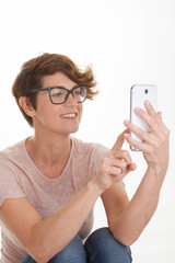 woman sending text from smart phone.