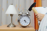 Smashing Alarm Clock with Hammer