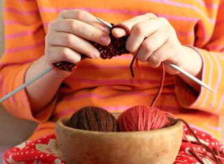 Baby hands knit clothes closeup.