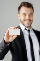 Man showing his business card.