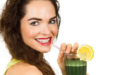 Woman enjoying a green smoothie.
