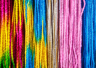 Many colorful mulberry rope arrange in vertical