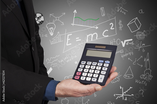 calculator in hand on background with formulas