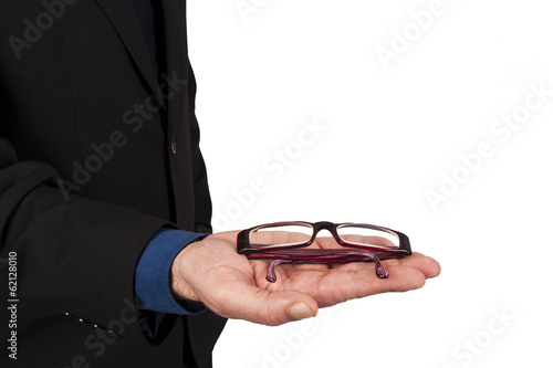 businessman holding glasses in hand in foreground