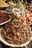 morrocan herbs flowers spices - cassia barks - in the Marrakesh
