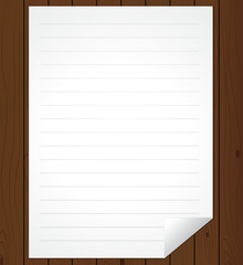 White paper sheet on wooden background.