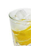 Water with lemons and ice cube isolated (selective focus)