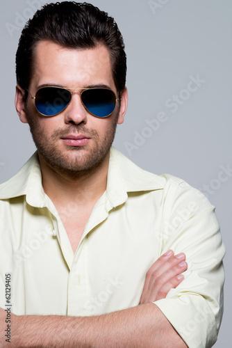 Portrait of handsome man in yellow shirt.