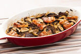 baked chicken livres with bacon and mushrooms on garlic