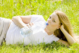 lying woman with bottle of water