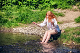 rural red-haired girl  on the river
