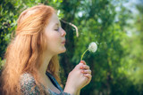 rural red-haired girl with a dandelion