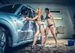 Models at the car wash in garage