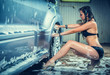Model at the car wash in garage