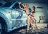 Models at the car wash in garage