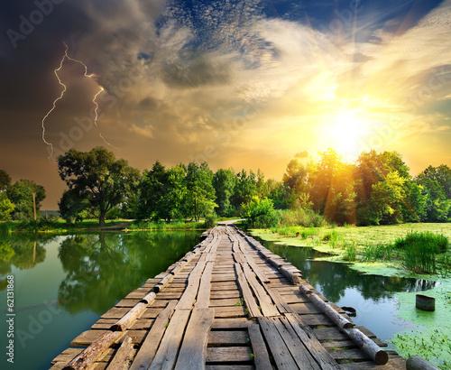 Zdjęcia na płótnie, fototapety, obrazy : Lightning over the wooden bridge