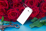 crimson roses with empty tag