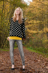 Blond smiling teen in the autumn