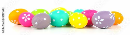 Colorful pile of Easter eggs arranged as a border