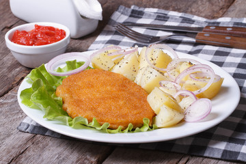 Schnitzel with young boiled potatoes