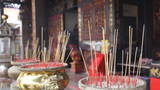Burning Joss Sticks for Blessings in Buddhist Temple 1080p