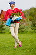 Gardening, planting - woman with geranium flowers