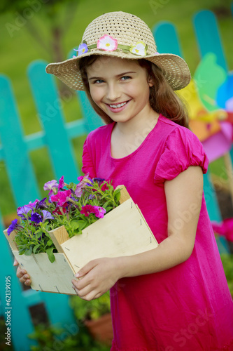 Gardening, planting -  girl  working in flowers garden