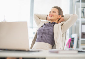Portrait of relaxed business woman in office