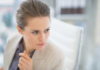 Portrait of concerned business woman in office