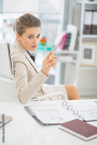 Business woman discussing in office and pointing in camera