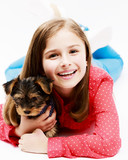 Young girl with cute  Yorkshire puppy