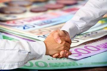 Handshake and Euro Banknotes Background
